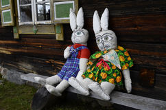Two lovely rabbit dolls sitting near window. Ethnographic museum in Lithuania. Rumsiskes, Lithuania Stock Photos
