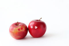 Two lovely red apples on a white background Royalty Free Stock Images