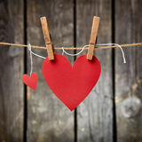 Two lovely red hearts on the clothesline. Stock Photography