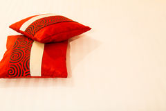 Two lovely red pillows on the white bed in bedroom Stock Photo