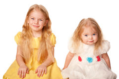 Two lovely sisters. Preschooler and baby girl. Royalty Free Stock Photography