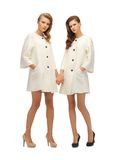 Two lovely teenage girls in white coats Royalty Free Stock Photo