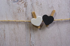 Two lovely white and Black  hearts  on the clothesline. Royalty Free Stock Photography
