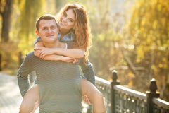 Two lovers in the autumn park Stock Image