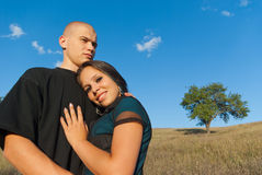 Two lovers on a background field Royalty Free Stock Photos
