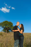 Two lovers on a background field Royalty Free Stock Photo