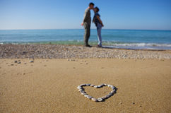 Two lovers on the beach Royalty Free Stock Image
