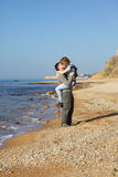 Two lovers on the beach. Two lovers walking on the beach Royalty Free Stock Image