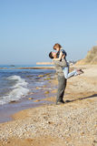 Two lovers on the beach. Two lovers walking on the beach Stock Photo