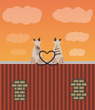 Two lovers cats on the roof. A couple of cats in love sitting on the top of the roof Royalty Free Stock Image