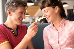 Two lovers chatting and having fun in the cafe Stock Photos