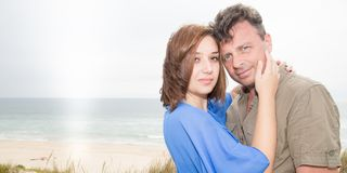 Two lovers couple on holiday vacation, enjoy life and hug on beautifull beach. Summer Royalty Free Stock Photos