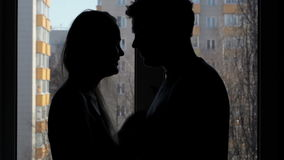 Two lovers embracing and kissing. Silhouette. stock video footage