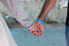 Two lovers holding hands gently together. Close-up Holding Hands Stock Photography