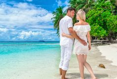 Two lovers, hugging each other strolling along the Maldivian isl Stock Images