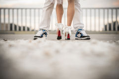 Two lovers. Huging and kissing. Only feets are seen Royalty Free Stock Images