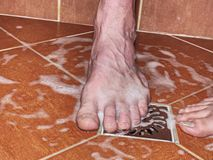 Lovers, man and woman barefoot in shower royalty free stock photo