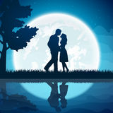Two lovers on the moon background Stock Image