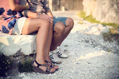 Two lovers are next, sitting on a rock of marble in Carrara Stock Photo