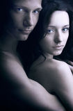 Two lovers over dark background Royalty Free Stock Photos