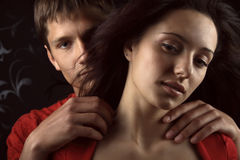 Two lovers over dark background Stock Photos