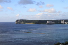 Two lovers point from Tumon beach in Guam Stock Photography