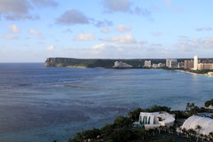 Two lovers point from Tumon beach in Guam Royalty Free Stock Image