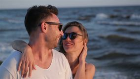 Two Lovers Spending Time Together near the Sea and Hugging on Waves Background. stock video
