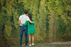 Two lovers standing on the top of the hill royalty free stock images