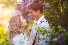Two lovers in summer garden Stock Photography
