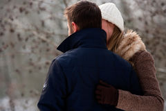 Two lovers in winter time stock photo