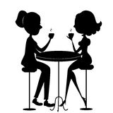 Two lovers women drinking coffee.Vector black silh Stock Image