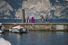 Two loving on biketour. They make a break on the lake Stock Photo