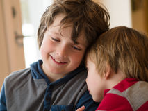 Two brothers hugging. Two loving brothers hugging each other stock photo