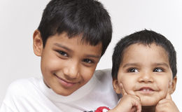 Two loving brothers in indoors Royalty Free Stock Photography