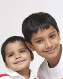 Two loving brothers in indoors Stock Images