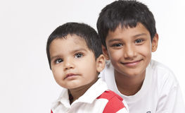 Two loving brothers in indoors Royalty Free Stock Images