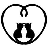 Two loving cats in the heart of tails Royalty Free Stock Photos