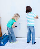 Two loving siblings decorating their house Royalty Free Stock Photo