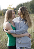 Two loving sisters comforting each other Stock Photo