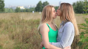 Two loving sisters comforting each other stock video footage
