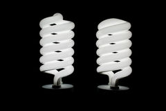 Two low energy spiral light bulbs Royalty Free Stock Photography