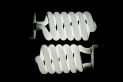 Two low energy spiral light bulbs Stock Images