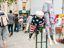 Two lower body mannekins in stretch pants at outdoor market in L Stock Images