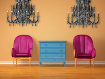 Two luxurious chairs with bedside and chandeliers Royalty Free Stock Images