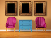 Two luxurious chairs with bedside and frames Royalty Free Stock Photos