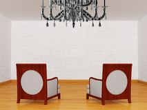 Two luxurious chairs with chandelier Royalty Free Stock Image