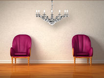 Two luxurious chairs with silver chandelier Royalty Free Stock Photos