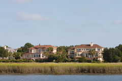 Two Luxury Homes Beyond Coastal Salt Marsh Stock Images