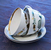 Two luxury white cups for tea and two plates Stock Photos